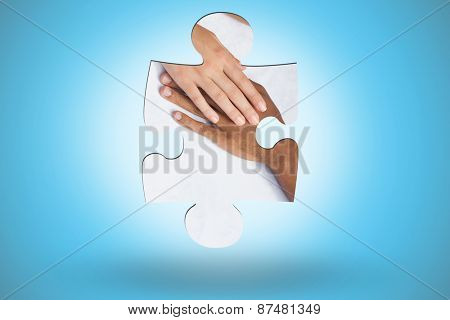 Couple having coffee together holding hands against blue background with vignette