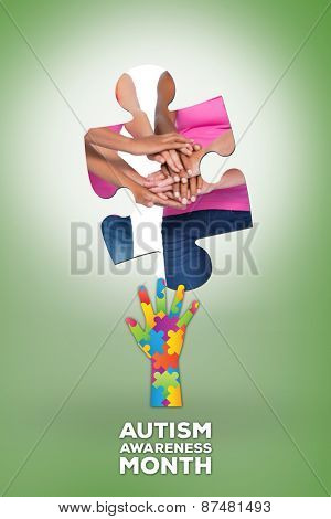 Happy women wearing breast cancer ribbons putting hands together smiling against green vignette