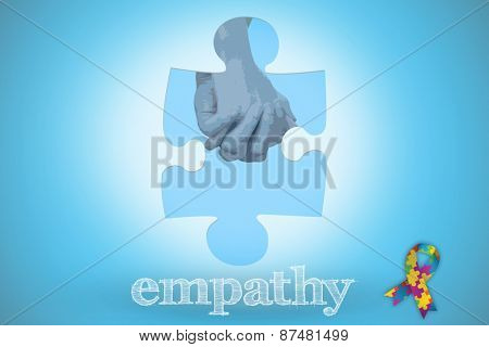 The word empathy and couple in check shirts and denim holding hands against blue background with vignette