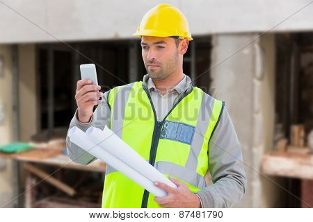 Architect on the phone against workshop