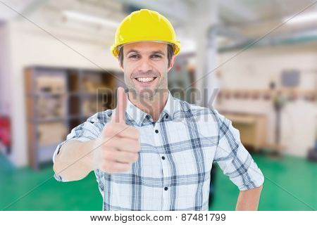 Architect showing thumbs up over white background against workshop
