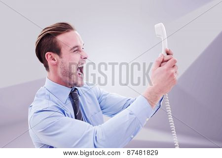 Businessman shouting at phone against abstract white room