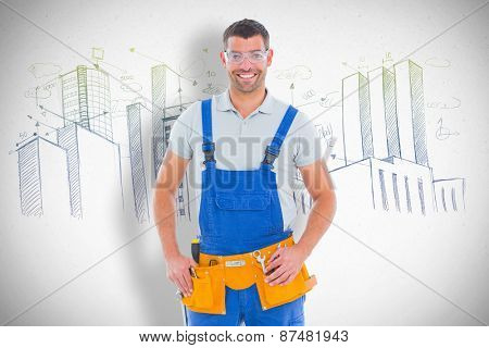 Confident manual worker against grey