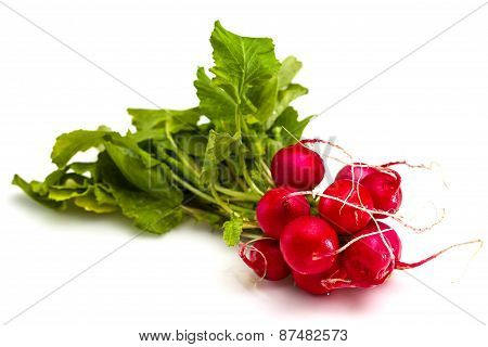 Bunch Of Fresh Red Radishes With Green Tops Isolated On White Background