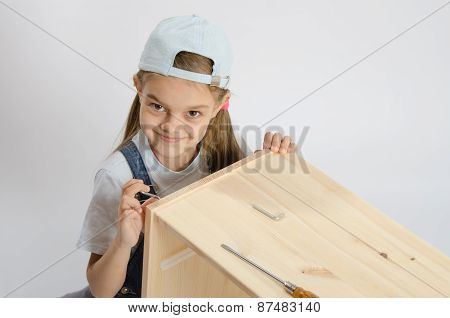 Little Girl In Image Collector Of Furniture Turn Screw