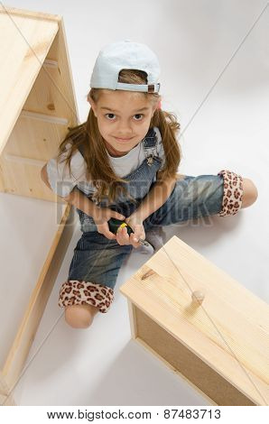Little Girl In Overalls Collector Furniture Spins Screwdriver