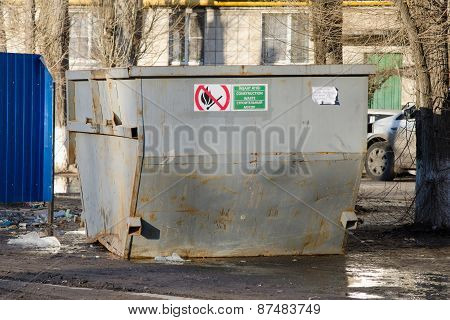 Large Garbage Container On The Background Of Dirty Streets