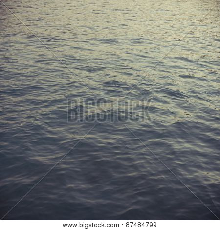 Tranquil sea water from top angle. An abstract nature background.