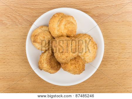 Butter Cookies In White Glass Saucer On Wooden Table