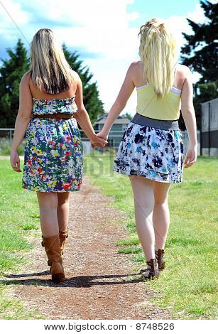 Friends Walking And Holding Hands