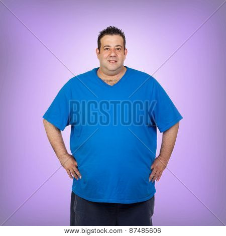 Happy fat man with blue shirt and a purple background