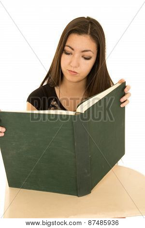 Cute Female Student Reading A Large Text Book