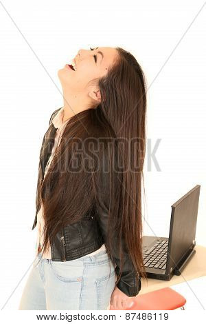 Cute Teen Girl By Computer With Her Head Back Laughing