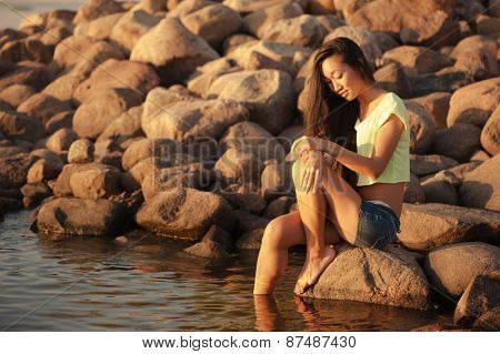 Woman playing with water outdoors