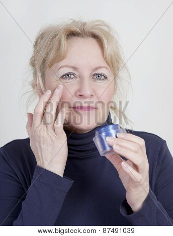 Elderly Woman With Wrinkle Cream