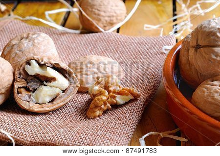 Group Of Healthy Walnuts On A Wooden Table