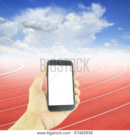 Hand Holding Smart Phone At Curve Of A Running Track