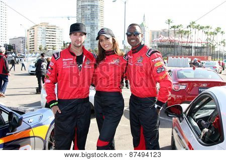 LOS ANGELES - FEB 7:  James Maslow, Donna Feldman, Willie Gault at the Toyota Grand Prix of Long Beach Pro/Celebrity Race Press Day at the Grand Prix Compound on FEB 7, 2015 in Long Beach, CA