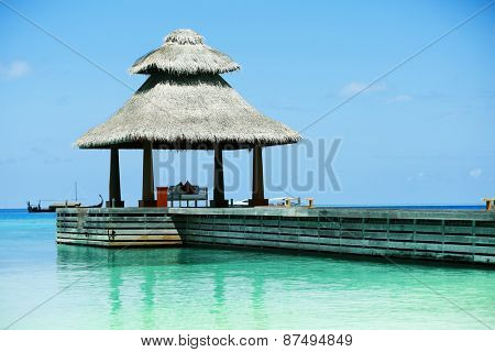 Boardwalk to arbor over blue ocean in Baros Maldives