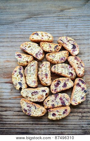 Cantuccini cookies with cranberry on wooden table