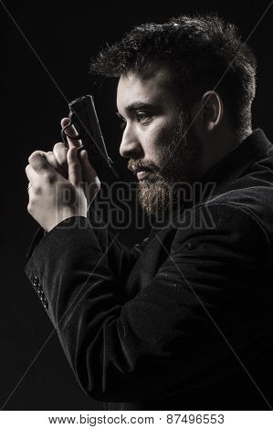Goatee Young Man With Gun Facing Left