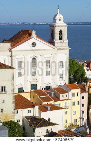 Alfama downtown and Santo Estevao Church in Lisbon, Portugal.