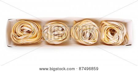 Packaged pasta tagliatelle nests isolated on white