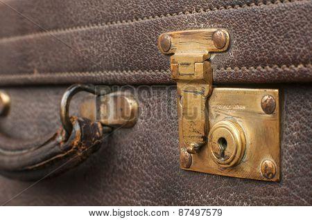 Old retro leather suitcase closeup