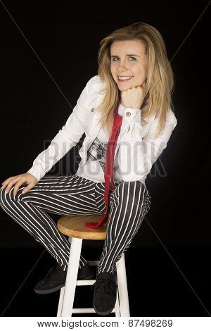 Female Model Sitting On Stool Wearing Striped Pants Smiling