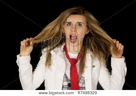 Freaking Out Young Female Pulling Hair Black Background
