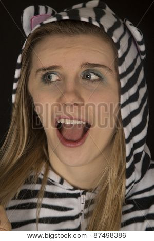 Young Woman Wearing Cat Pajamas Surprised Facial Expression
