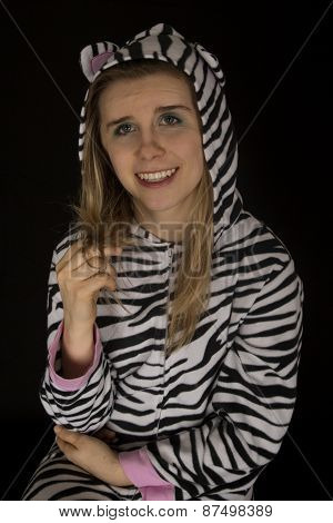 Young Woman Wearing Cat Pajamas Playing With Her Hair
