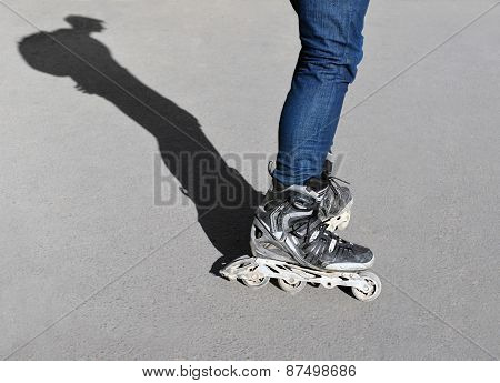 Legs And Shadow Teenager On Roller Skates