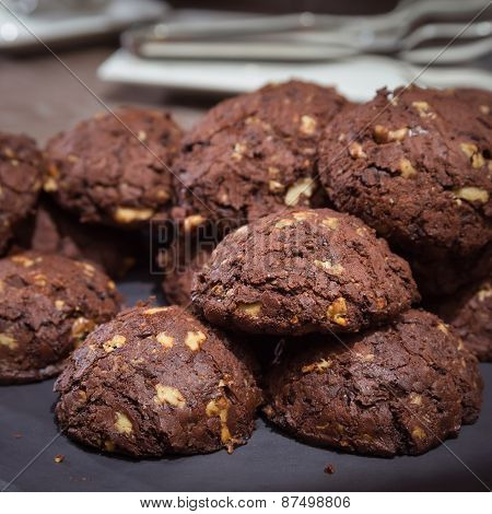 Chocolate And Nut Cookies On Wooden Table