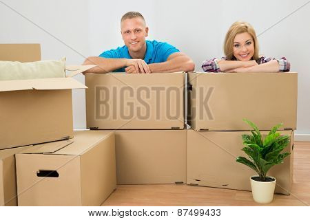 Couple With Cardboard Boxes