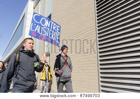 Male Students Holding Blue Pancard Against Gouvernement Austerity Plans