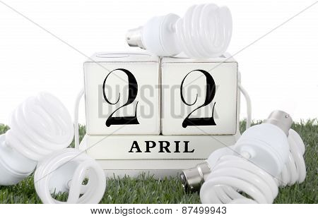 Earth Day, April 22, Concept With Energy Saving Light Bulbs.