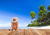 stock photo of sunny beach  - Woman Sunbathe Sunny Summer Beach Relaxing Concept - JPG