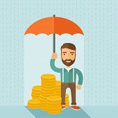 foto of money  - A businessman with beard standing holding umbrella protecting his money to investments - JPG