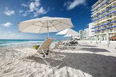 image of beachfront  - Caribbean beach with sun umbrellas and beds Cancun Mexico - JPG