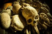 stock photo of catacombs  - dark ages skulls in a cemetery Naples - JPG