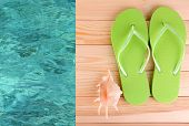 image of beside  - Colored flip flops on wooden platform beside sea - JPG