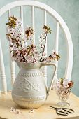 pic of scissors  - Spring blossom in antique pottery vase with scissors on rustic chair - JPG