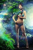 stock photo of tropical plants  - Full length portrit of a beautiful sexy woman in bikini among tropical plants - JPG