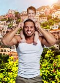 picture of little girls photo-models  - Happy father with little daughter against colorful town background - JPG