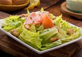 picture of chive  - A delicious smoked salmon caesar salad with smoked salmon croutons chives and capers - JPG