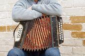 stock photo of accordion  - accordion on the man - JPG