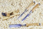 picture of chisel  - Three chisels and one spokeshave lying in wooden shavings - JPG
