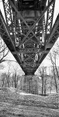 stock photo of trestle bridge  - Underside of an old steel trestle railroad bridge that crosses the Erie Canal at Lockport New York - JPG