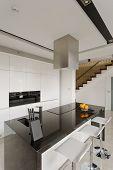 foto of granite  - Oranges on granite worktop in modern kitchen - JPG